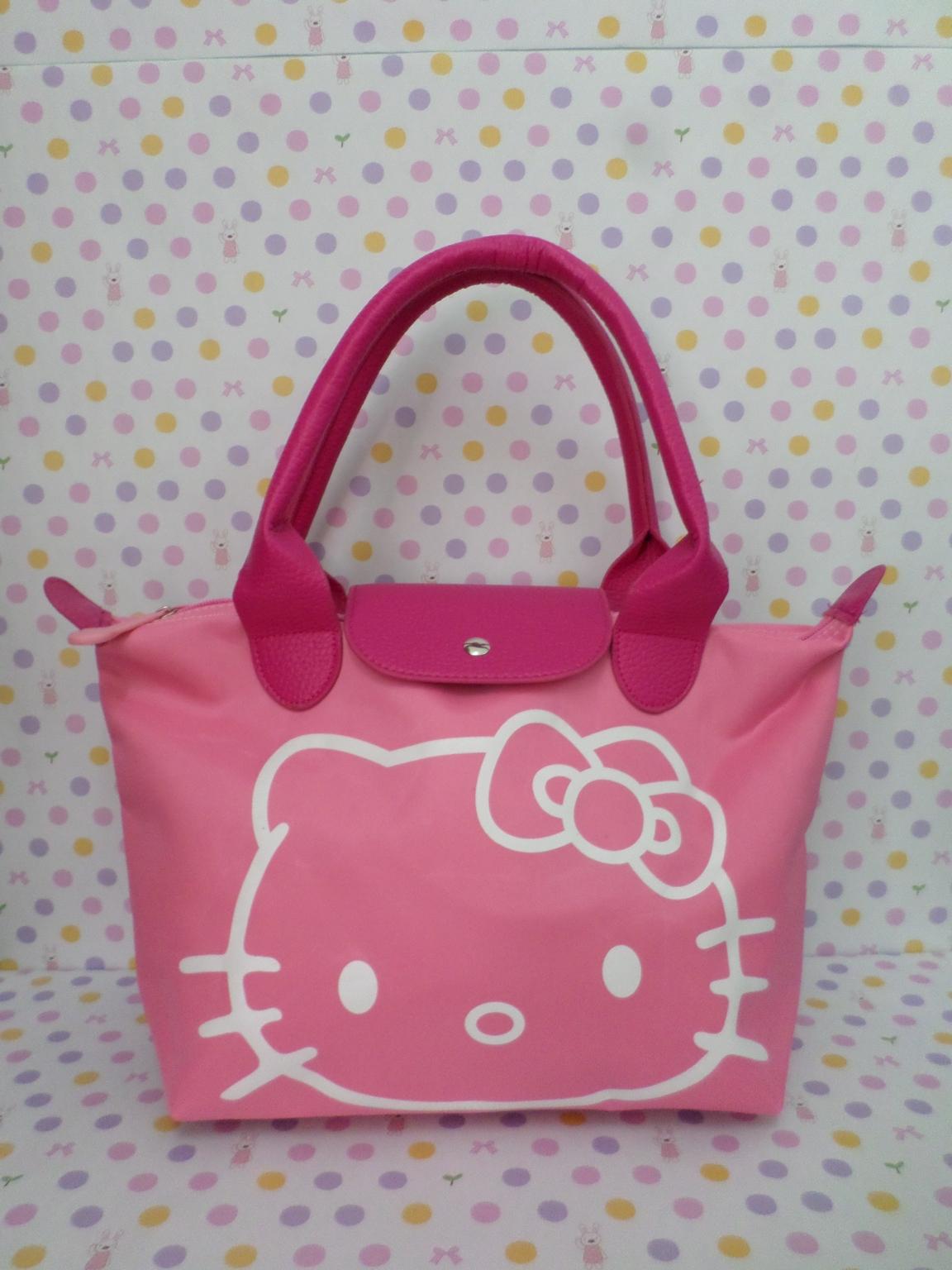 กระเป๋าถือหูหิ้ว ฮัลโหลคิตตี้ Hello kitty#2 ทรง LC ขนาด กว้าง 14 ซม. * ยาว 35 ซม. * สูง 22 ซม. สีชมพู ลายหน้าคิตตี้โบว์